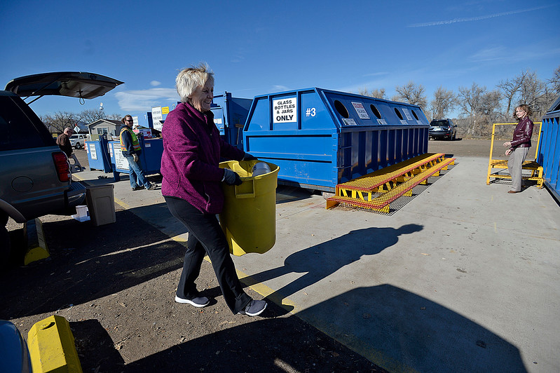 Marsha Tintes of Loveland carries her recycleables to the right bin Wednesday, Nov. 15, 2017, at the Loveland Recycling Center. CoPIRG and Eco-Cycle marked America Recycles Day on Wednesday by releasing sobering numbers on Colorado's statewide and local recycling rates. According to a report by CoPIRG and Eco-Cycle Loveland has the best residential recycling rate in the state at 61 percent, copared to the national average at 34 percent.   (Photo by Jenny Sparks/Loveland Reporter-Herald)