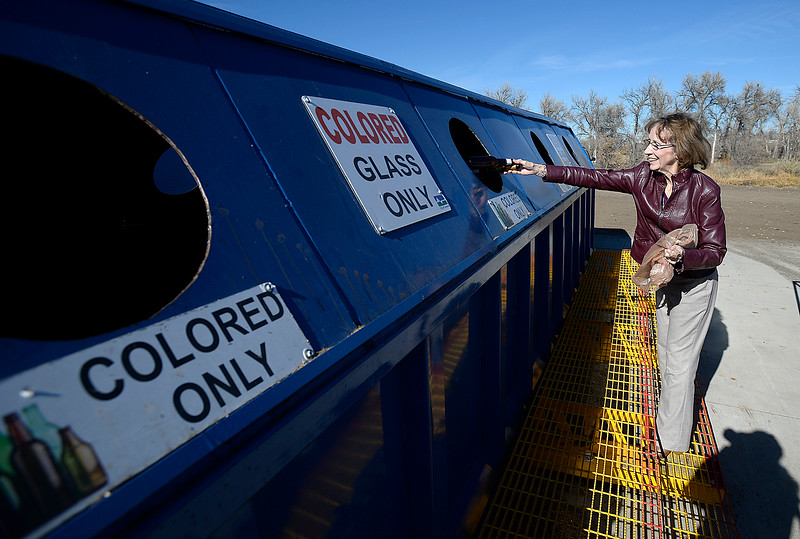 Jan Door tosses a glass bottle into a bin Wednesday, Nov. 15, 2017, at the Loveland Recycling Center. CoPIRG and Eco-Cycle marked America Recycles Day on Wednesday by releasing sobering numbers on Colorado's statewide and local recycling rates. According to a report by CoPIRG and Eco-Cycle Loveland has the best residential recycling rate in the state at 61 percent, copared to the national average at 34 percent.   (Photo by Jenny Sparks/Loveland Reporter-Herald)