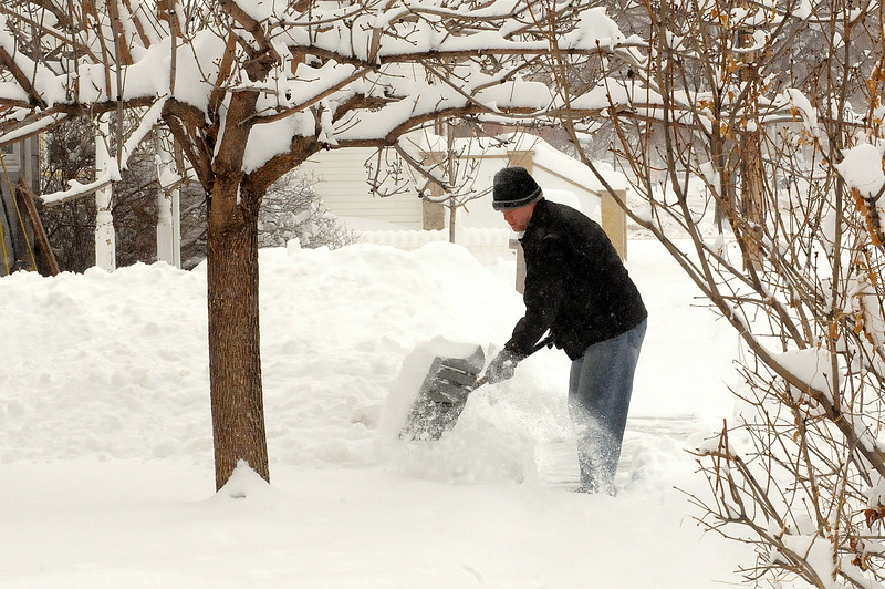 Jeff Meier shovels snow in front of his house at 418 N. Adams Ave. in Loveland on Tuesday, Feb. 2, 2016. More than a foot of snow blanketed the city from the storm that started Sunday night. (Photo by Craig Young/Loveland Reporter-Herald)