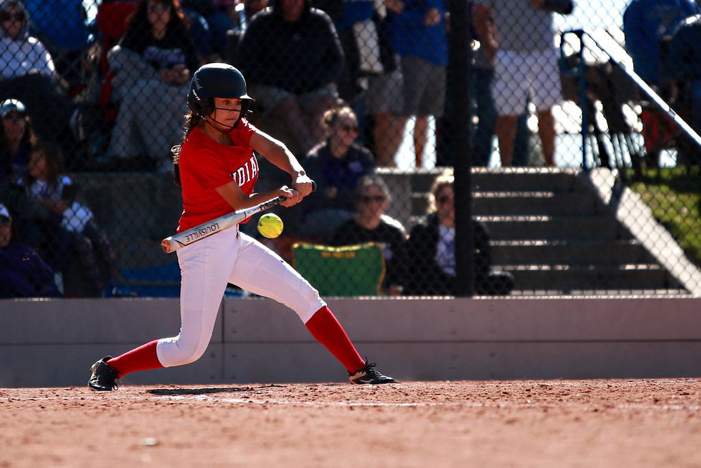 . Loveland�s (4) Emma Duran hits the ball as she is up to bat at their match against Arvada West at the state championships for high school softball at Aurora Sports Park on Oct. 19, 2018 in Aurora, Colo. Photo by Taelyn Livingston/ Loveland Reporter-Herald