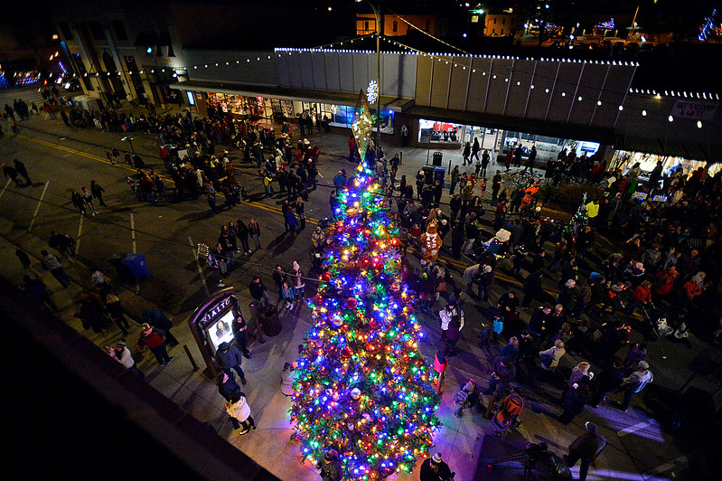 People gather for the lighting of the Christmas tree Wednesday, Nov. 29, 2017, during the Festival of Lights on Fourth Street in downtown Loveland.    (Photo by Jenny Sparks/Loveland Reporter-Herald)