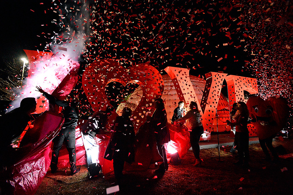 ". Confetti rains down as Loveland officials uncover and unveil the Love Locks sculpture Thursday, Jan. 3, 2019, during the kick off to the Loveland Valentine Remailing Program at the Loveland Chamber of Commerce. Artist Doug Rutledge designed the over 10 foot tall 36 foot wide sculpture and Jeff Beatty constructed the piece where people can ""Lock\"" their love by putting a pad lock on the back of the sculpture.  (Photo by Jenny Sparks/Loveland Reporter-Herald)"
