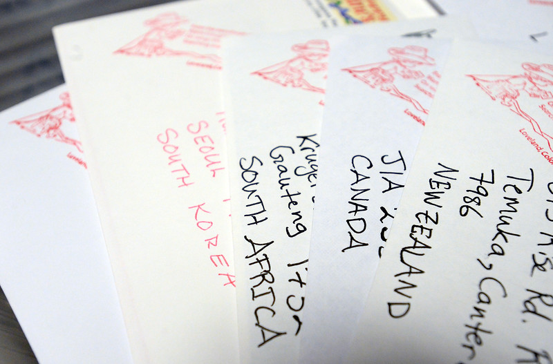 Valentines from all over the world wait to be hand cancelled after having a cachet stamped on them Wednesday, Feb. 1, 2017, during the kick off to the Loveland Valentine Re-Mailing Program at the Chamber of Commerce in east Loveland. (Photo by Jenny Sparks/Loveland Reporter-Herald)
