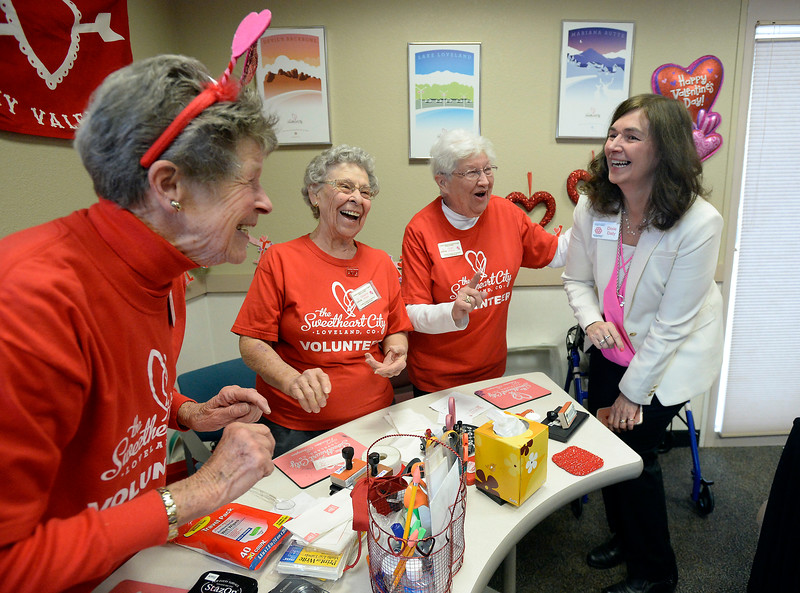 Janice Gibb, left, Delaine Phillips, center left, and Joan Williams, center right, sing a song and do a little dance with Chamber of Commerce employee Dixie Daly, right, Wednesday, Feb. 1, 2017, during the kick off to the Loveland Valentine Re-Mailing Program at the Chamber of Commerce in east Loveland. It is the 71st year of the re-mailing program where valentines from all over the world are sent to Loveland to be postmarked and stamped with a special cachet. (Photo by Jenny Sparks/Loveland Reporter-Herald)