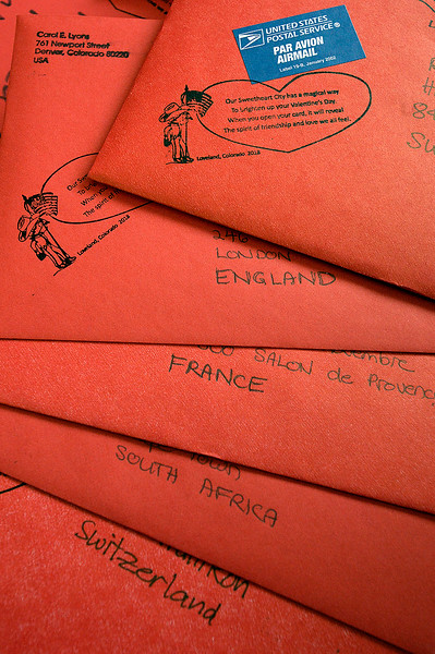Valentines addressed to England, France, South Africa and Switzerland are among thousands of valentines to be stamped Thursday, Feb. 1, 2018, during the kick-off to the valentine stamping for the Loveland Valentine Re-mailing program at the Loveland Chamber of Commerce.    (Photo by Jenny Sparks/Loveland Reporter-Herald)