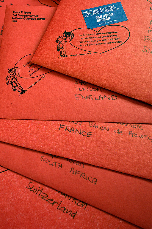 . Valentines addressed to England, France, South Africa and Switzerland are among thousands of valentines to be stamped Thursday, Feb. 1, 2018, during the kick-off to the valentine stamping for the Loveland Valentine Re-mailing program at the Loveland Chamber of Commerce.    (Photo by Jenny Sparks/Loveland Reporter-Herald)