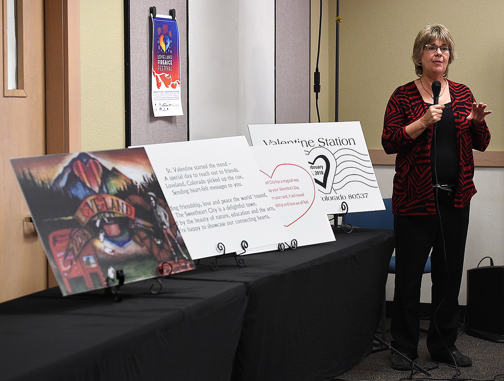 . Loveland Postmaster Cindy Kinney talks about the Loveland Valentine Re-mailing program Tuesday, Jan. 2, 2018, during the unveiling of this year\'s Valentine card, cachet and verse at the Loveland Chamber of Commerce in east Loveland. (Photo by Jenny Sparks/Loveland Reporter-Herald)