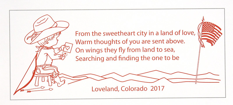 The official 2017 Loveland Valentine Remailing program's cachet and cachet verse that were unveiled Tuesday, Jan 3, 2016, at the Loveland Chamber of Commerce. Richard Schilling wrote the cachet verse and Cory McDowell designed it. (Photo by Jenny Sparks/Loveland Reporter-Herald)
