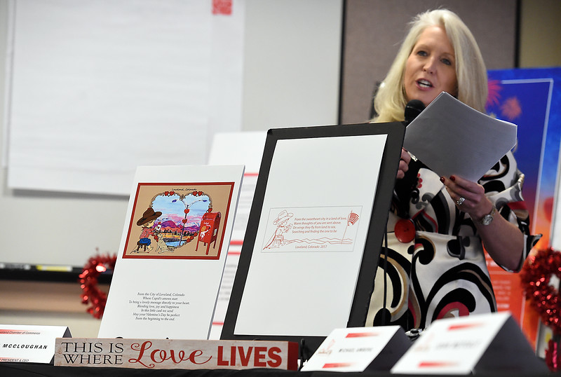 Mindy McCloughan, president and CEO of the Loveland Chamber of Commerce,   unveils the 2017 Valentine Remailing program card, cachet, verses and cancelation stampTuesday, Jan 3, 2016, at the Loveland Chamber of Commerce. (Photo by Jenny Sparks/Loveland Reporter-Herald)