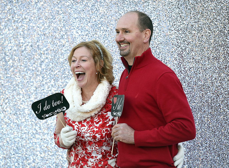 Terry and Linda Scott laugh while posing for a photo before getting married Tuesday, Feb. 14, 2017, during Loveland's first Valentine's Day group wedding at Foote Lagoon downtown. They took a flight from their home in Minnesota to get hitched in Loveland.  (Photo by Jenny Sparks/Loveland Reporter-Herald)