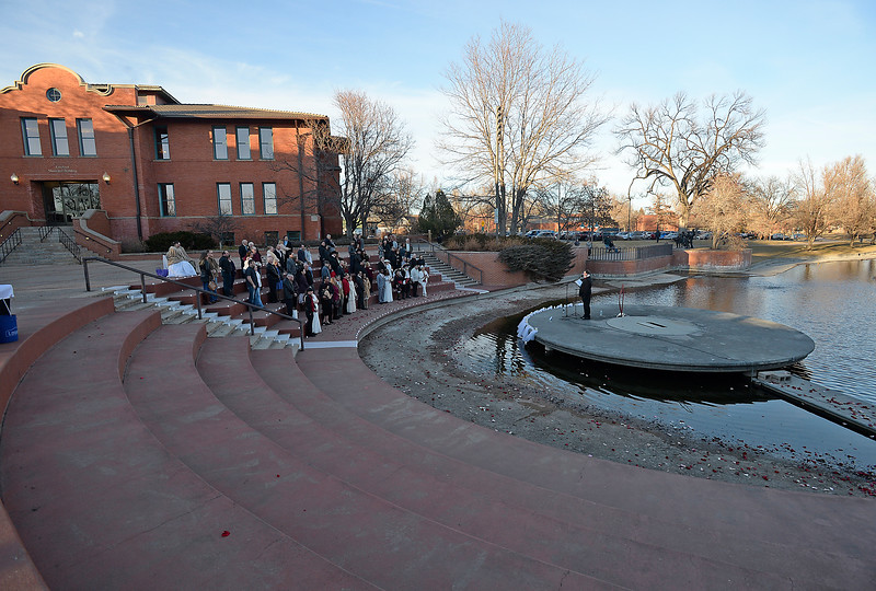 Couples get married Tuesday, Feb. 14, 2017, during Loveland's first Valentine's Day group wedding on the steps of Foote Lagoon downtown.   (Photo by Jenny Sparks/Loveland Reporter-Herald)
