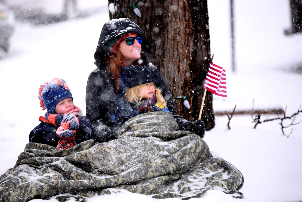 . Cindy Kirby, whose husand is currently deployed,  and her children Arlie and Lily watch the anual Veterans Day parade on Nov. 11, 2018 in Loveland, Colo.