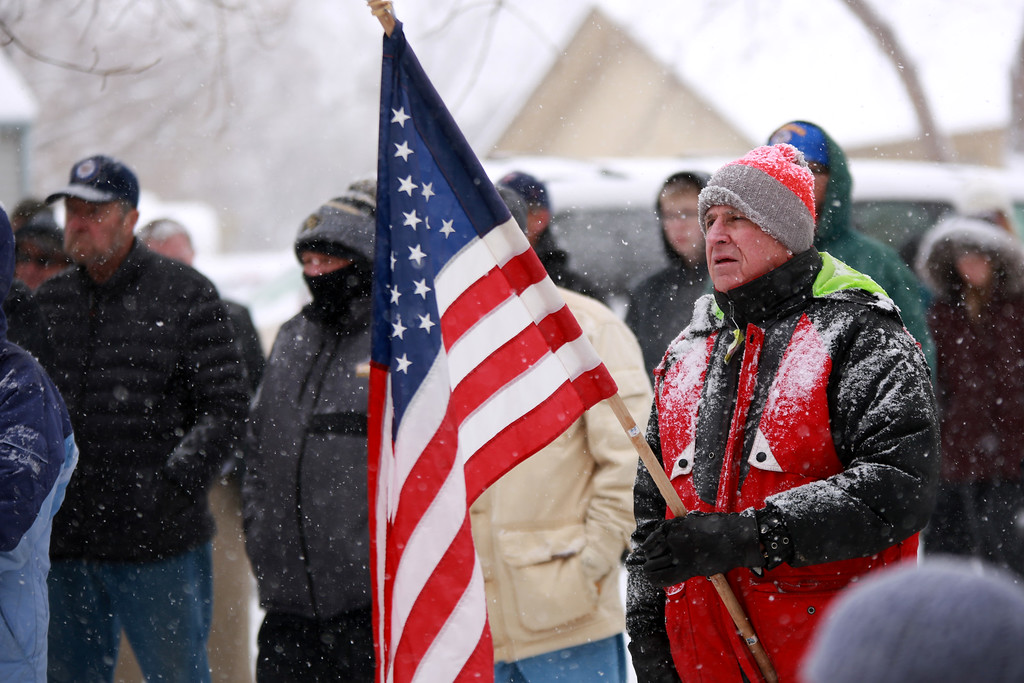 . Jack Huffman holds his flag during the Veterans Day Parade ceremony at Dwayne Webster Veterans Park on Nov. 11, 2018 in Loveland, Colo.
