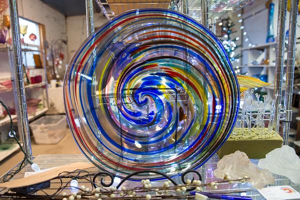 Photographs of Dan Daggett's glass work in his studio, Daggett Glass Studio. Photos from a photo shoot for Loveland and South Magazine. on December 18, 2019.