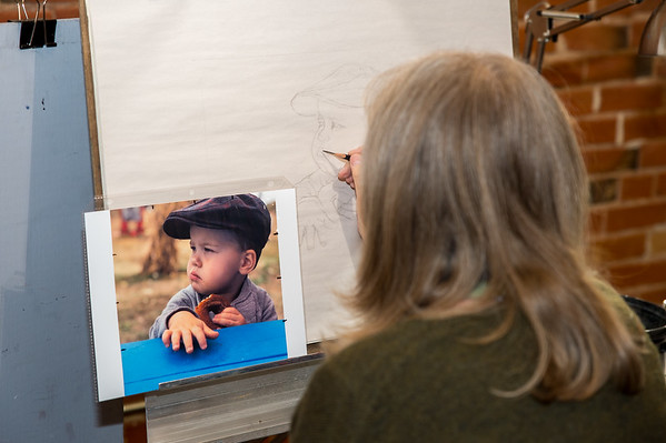 A student working on a portrait at Schissler Academy of Fine Arts in Loveland, CO.  Photos from a photo shoot for Loveland and South Magazine on December 18, 2019.