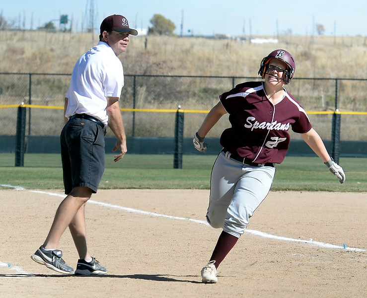 Berthoud's #27 Ashlynn Balliet rounds the bases after hitting a homerun during their game against Mullen at the 5A State Softball championships at the Aurora Sports Park on Friday, Oct. 21, 2016. (Photo by Jenny Sparks/Loveland Reporter-Herald)