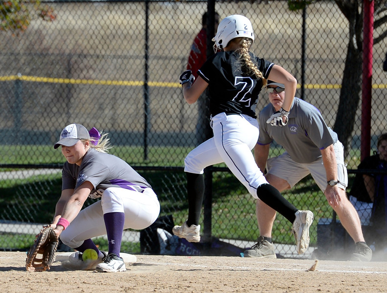 Mountain Views #2 Bre VanDenBosch runs to first base as Discovery Canyon's #11 misses the ball during their game at the 5A State Softball championships at the Aurora Sports Park on Friday, Oct. 21, 2016. (Photo by Jenny Sparks/Loveland Reporter-Herald)