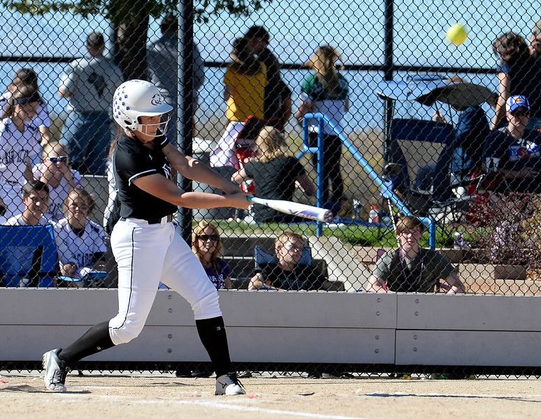 Mountain Views #19 Kailee Stobbe hits a homerun during their game against Discovery Canyon at the 5A State Softball championships at the Aurora Sports Park on Friday, Oct. 21, 2016. (Photo by Jenny Sparks/Loveland Reporter-Herald)