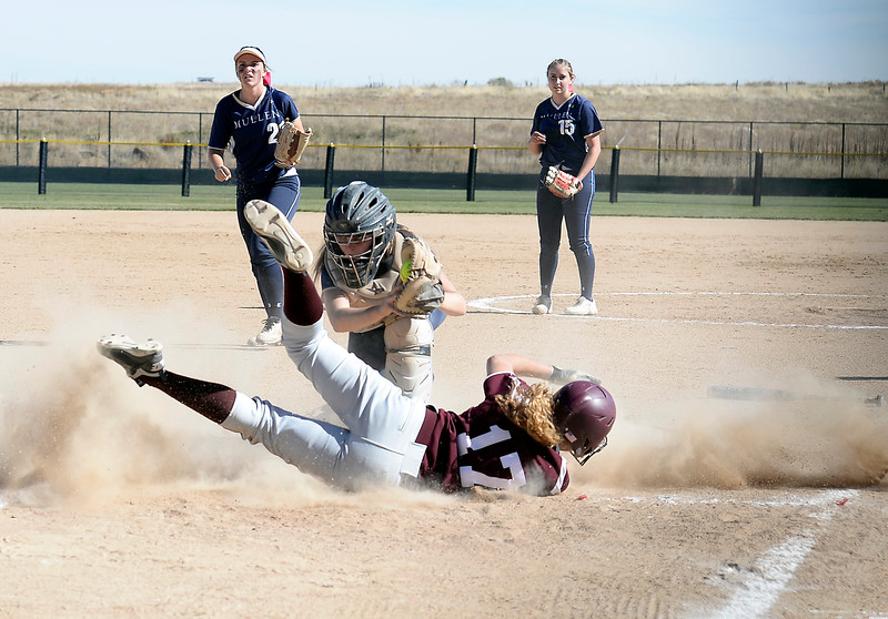 Berthoud's #17 Tristen Pope slides into home as Mullen's #8 Caley McKune tries to tag her out during their game at the 5A State Softball championships at the Aurora Sports Park on Friday, Oct. 21, 2016. (Photo by Jenny Sparks/Loveland Reporter-Herald)