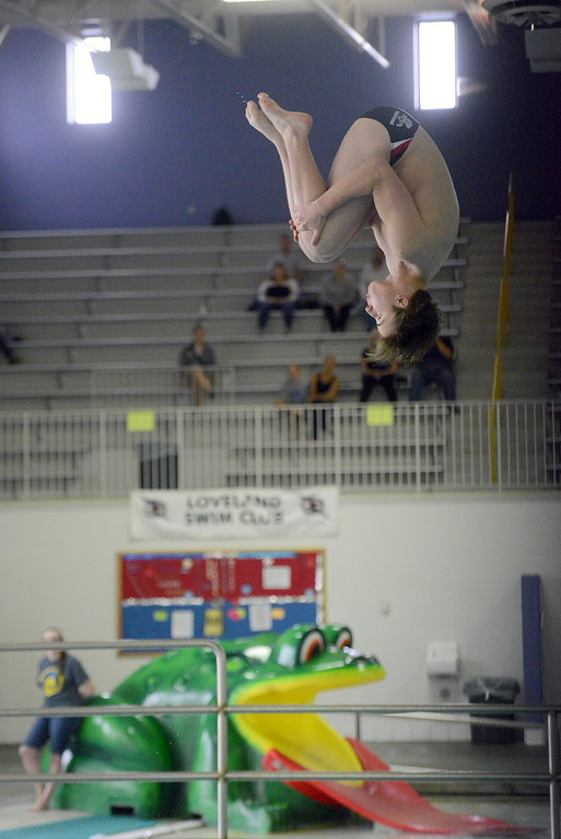 . Loveland diver James Greenup looks down to find the water as he hits the top in his tuck during the Front Range League Championships on Saturday at Mountain View Aquatics Center. (Mike Brohard/Loveland Reporter-Herald)