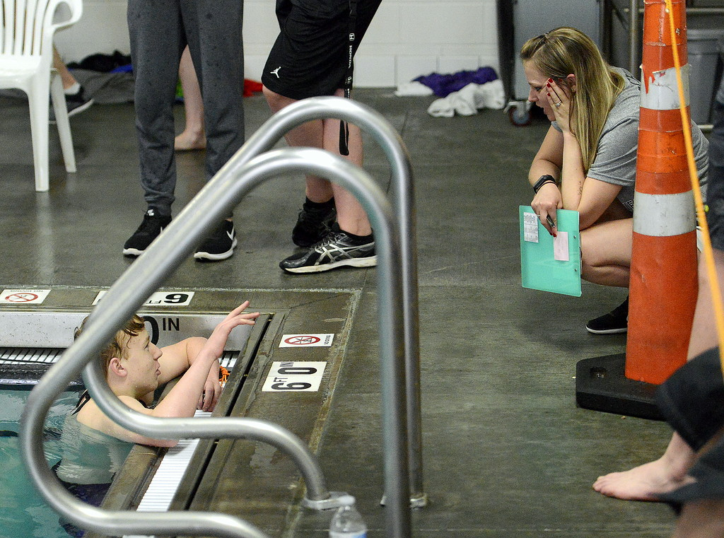. Loveland\'s Jakob Borrman talks to coach Sarah Vlatkovich at the end of the 200-yard freestyle during the Front Range League Championships on Saturday at Mountain View Aquatics Center. Borrman was sixth in the event and later placed fifth in the 100 free. (Mike Brohard/Loveland Reporter-Herald)