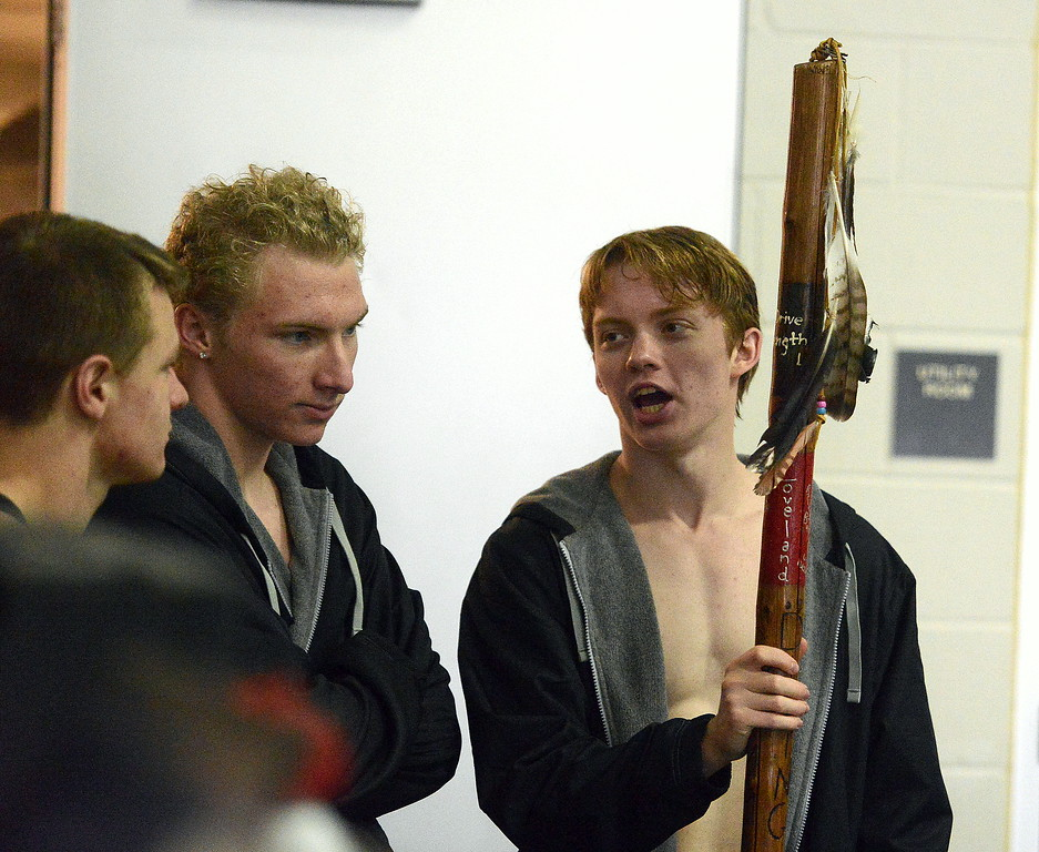 . Loveland\'s Jack Curtis holds on to the spirit stick during the  Front Range League Championships on Saturday at Mountain View Aquatics Center. (Mike Brohard/Loveland Reporter-Herald)