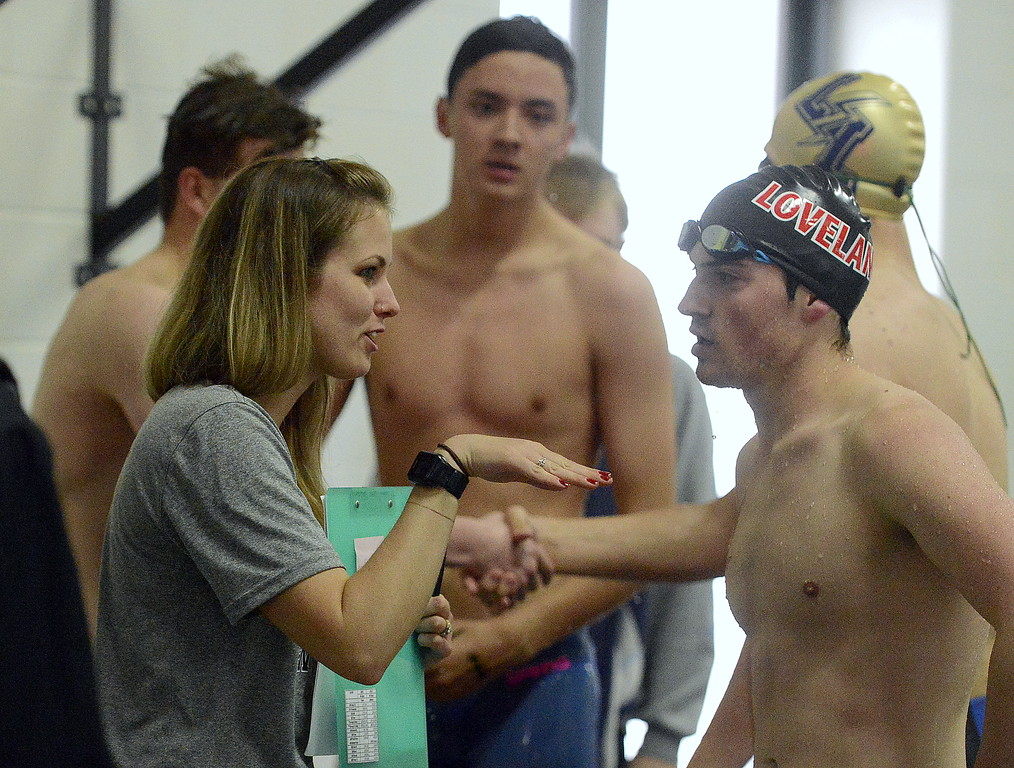 . Loveland coach Sarah Vlatkovich talks to Deven Gogarty after he won \'C\' final of the 50-yard freestyle during the Front Range League Championships on Saturday at Mountain View Aquatics Center. (Mike Brohard/Loveland Reporter-Herald)