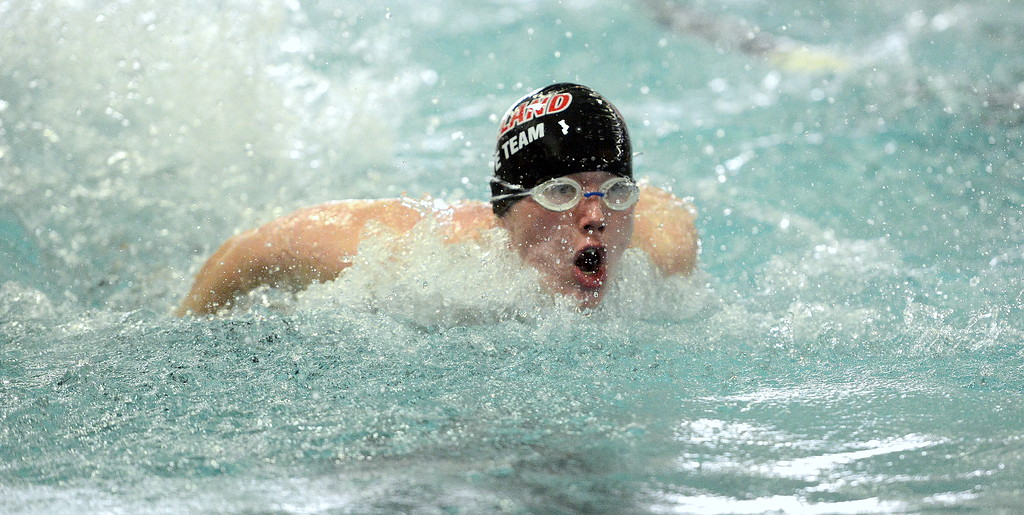 . Loveland\'s Connor Lindgren competes in the 100-yard butterfly the Front Range League Championships on Saturday at Mountain View Aquatics Center. (Mike Brohard/Loveland Reporter-Herald)