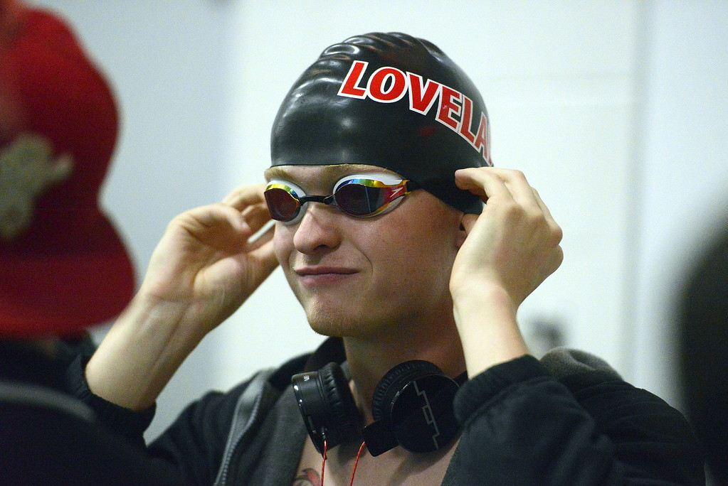 . Danny Turner of Loveland adjusts his cap and goggles as he gets ready to get in line for the walkout of the 100-yard breaststroke finals during the Front Range League Championships on Saturday at Mountain View Aquatics Center. (Mike Brohard/Loveland Reporter-Herald)