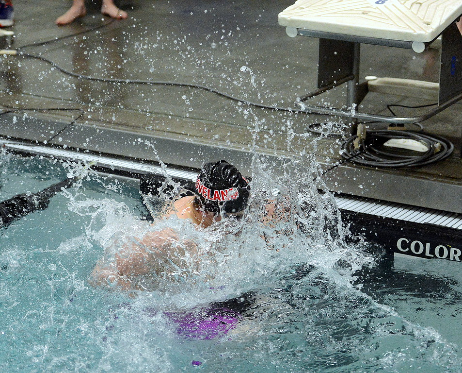 . Lovleand\'s Deven Gogarty hits the wall at the turn of the 100-yard butterfly during the Front Range League Championships on Saturday at Mountain View Aquatics Center. (Mike Brohard/Loveland Reporter-Herald)