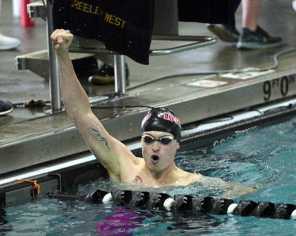. Loveland\'s Danny Turner shows his excitement after looking at the board and seeing his time of 2:02.28 to win the consolation heat of the 200-yard individual medley during the Front Range League Championships on Saturday at Mountain View Aquatics Center. (Mike Brohard/Loveland Reporter-Herald)