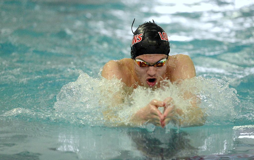 . Ashton Lyon of Loveland surges forward during his heat of the 100-yard breaststroke during the Front Range League Championships on Saturday at Mountain View Aquatics Center. (Mike Brohard/Loveland Reporter-Herald)
