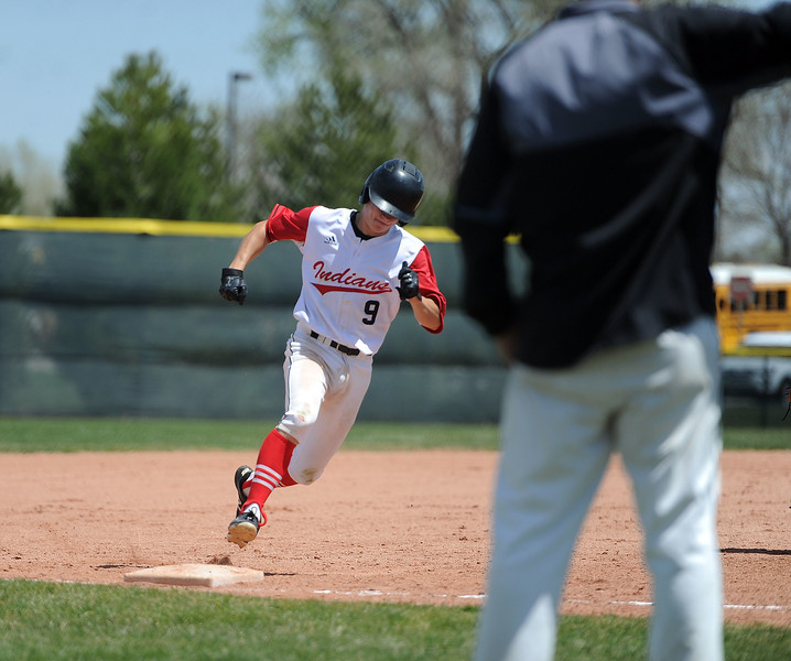 Tyler Hamill rounds third base and heads home against Greely West on Saturday, May 4. The Indians won 6-1 on senior day. (Colin Barnard/Loveland Reporter-Herald)