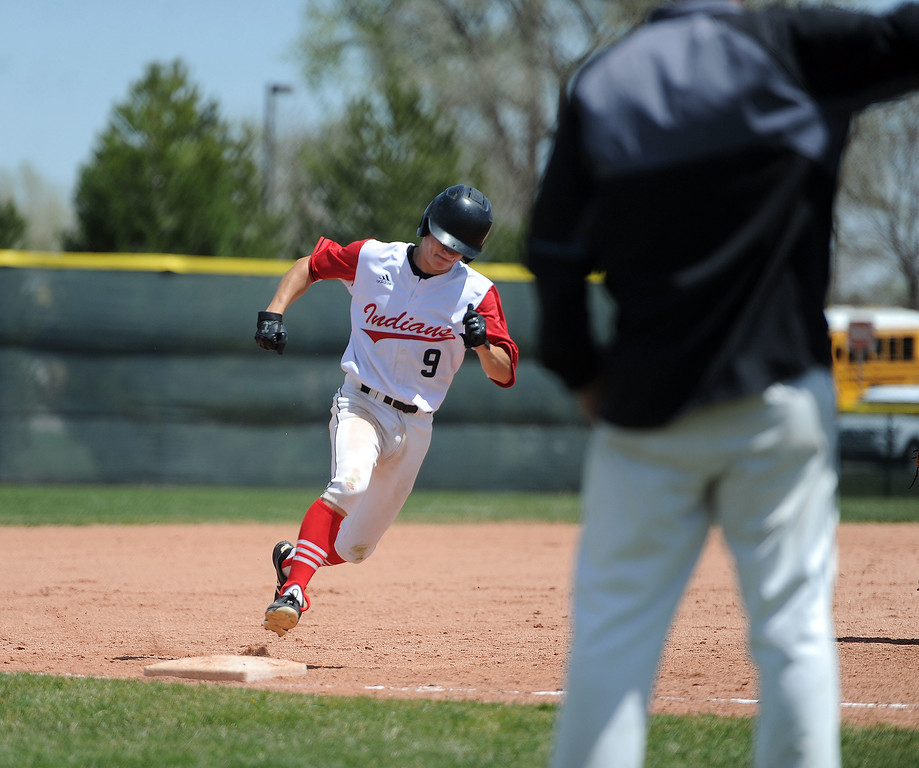 . Tyler Hamill rounds third base and heads home against Greely West on Saturday, May 4. The Indians won 6-1 on senior day. (Colin Barnard/Loveland Reporter-Herald)