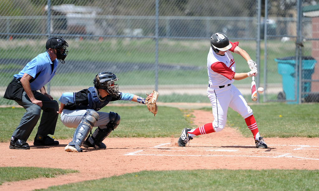 . Jackson Bakovich connects with a ball against Greely West on Saturday, May 4. The Indians won 6-1 on senior day. (Colin Barnard/Loveland Reporter-Herald)