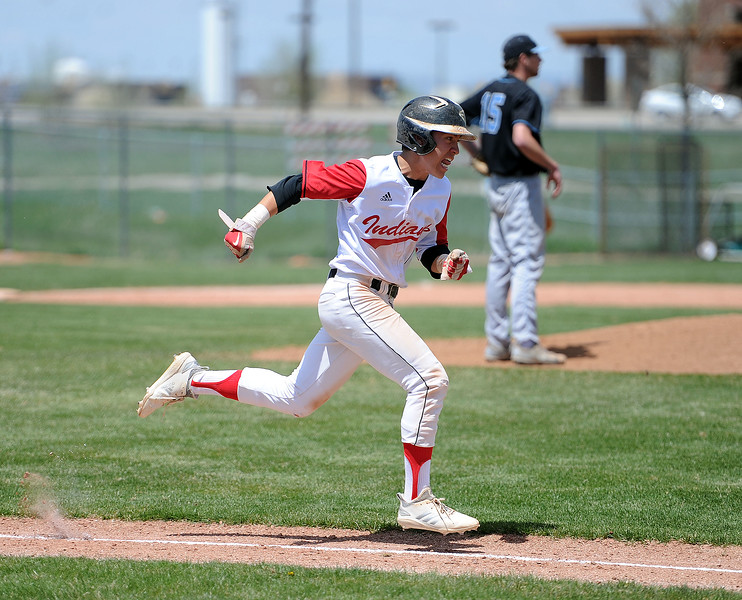 Jaxon Cabrera hustles down the first-base line against Greely West on Saturday, May 4. The Indians won 6-1 on senior day. (Colin Barnard/Loveland Reporter-Herald)