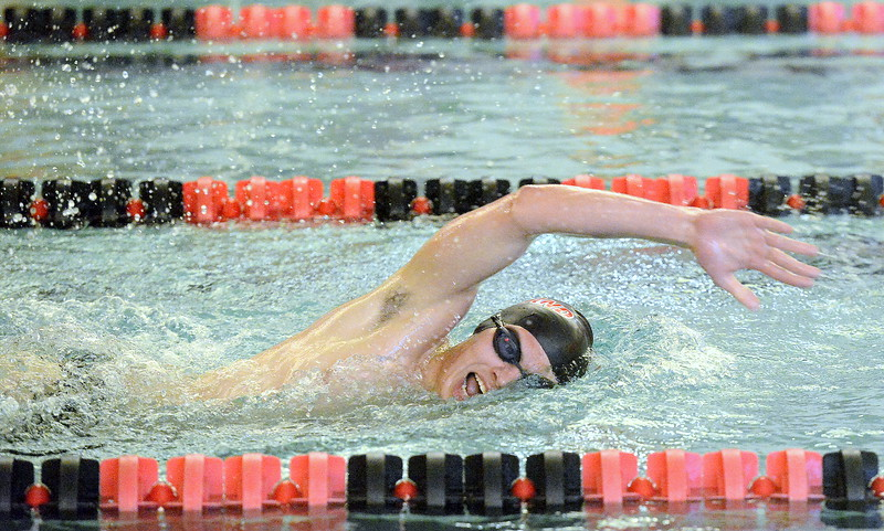 Loveland's Ashton Lyon takes in air on his way to winning the 500-yard freestyle during Tuesday's dual with Fort Collins at the LHS pool. (Mike Brohard/Loveland Reporter-Herald).