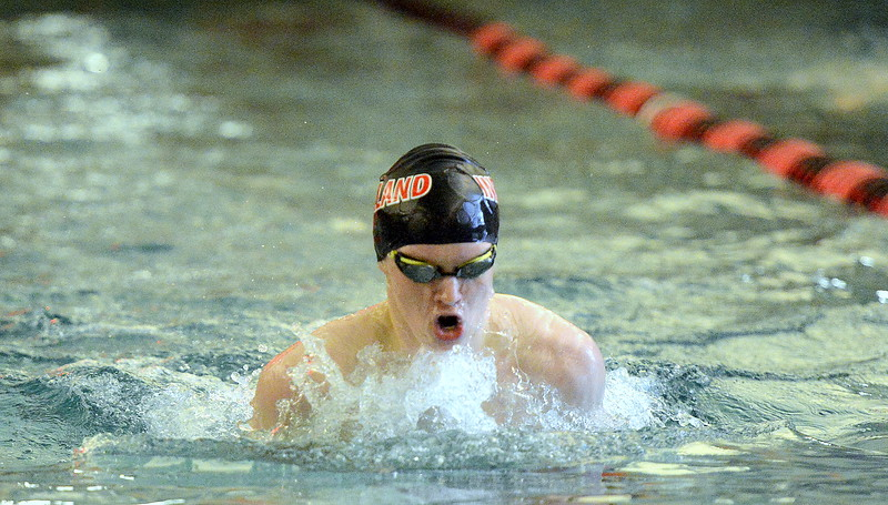 Loveland's Jack Curtis comes up during the breastroke leg of the 200-yard individual medley in Tuesday's dual with Fort Collins at the LHS pool. Curtis was third with a state time of 2:09.92. (Mike Brohard/Reporter-Herald).