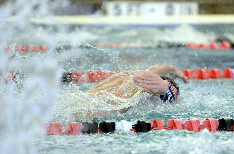 Aiden Duncan of Loveland follows through during the 100-yard butterfly during Tuesday's dual meet with Fort Collins at the LHS pool. Duncan took third at 1:00.60 and was one of three Indians to hit a state-qualigying time in the event. (Mike Brohard/Reporter-Herald).