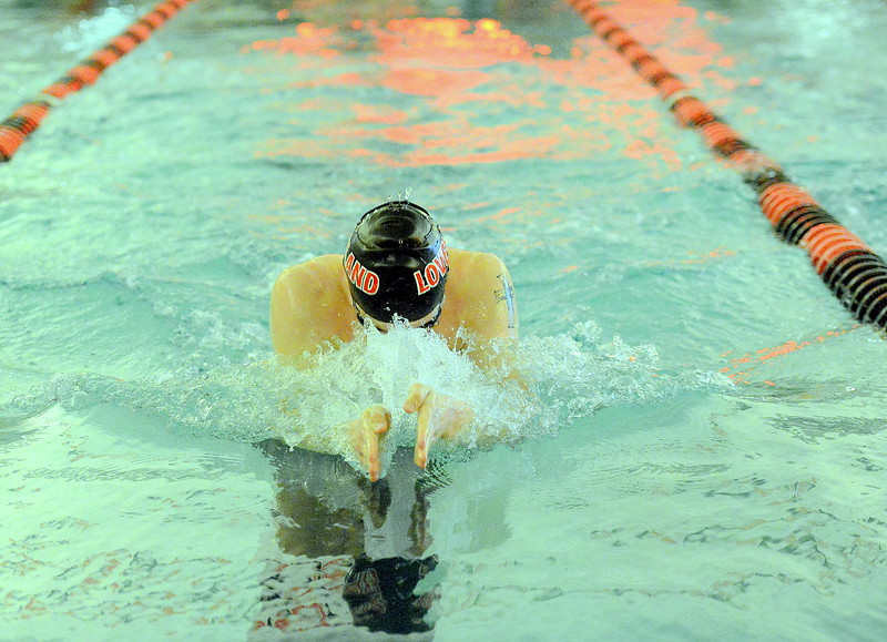 Loveland's Danny Turner chases his reflection during the 100-yard breaststroke in Tuesday's dual with Fort Collins at the LHS pool. Turner won with a state-qualifying time of 1:00.53. (Mike Brohard/Loveland Reporter-Herald).