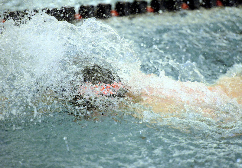 Loveland's Mathew Dennis puts his head down as he closes in on the first turn of the 100-yard freestyle during Tuesday's dual meet with Fort Collins at the LHS pool.  (Mike Brohard/Reporter-Herald).