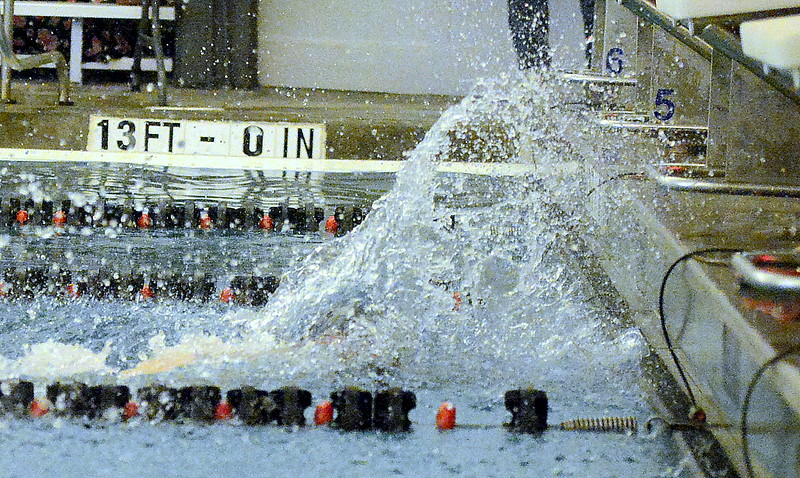 Jakob Borman of Loveland touches the wall to win the 50-yard freestyle during Tuesday's dual with Fort Collins at the LHS pool. Borman won with a state cut of 23.13. (Mike Brohard/Reporter-Herald).