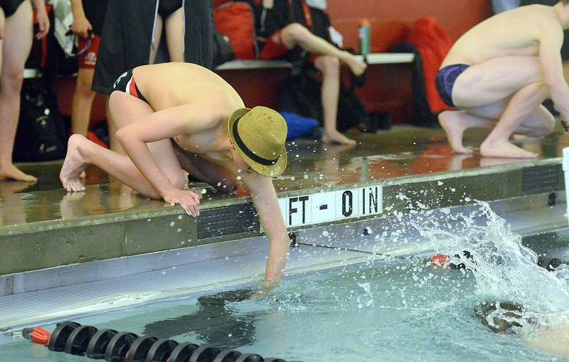 Loveland's Indiana Steving goes with alternate headgear to count for teammate Isaac Circenis during the 500-yard freestyle during Tuesday's dual with Fort Collins at the LHS pool. (Mike Brohard/Loveland Reporter-Herald).
