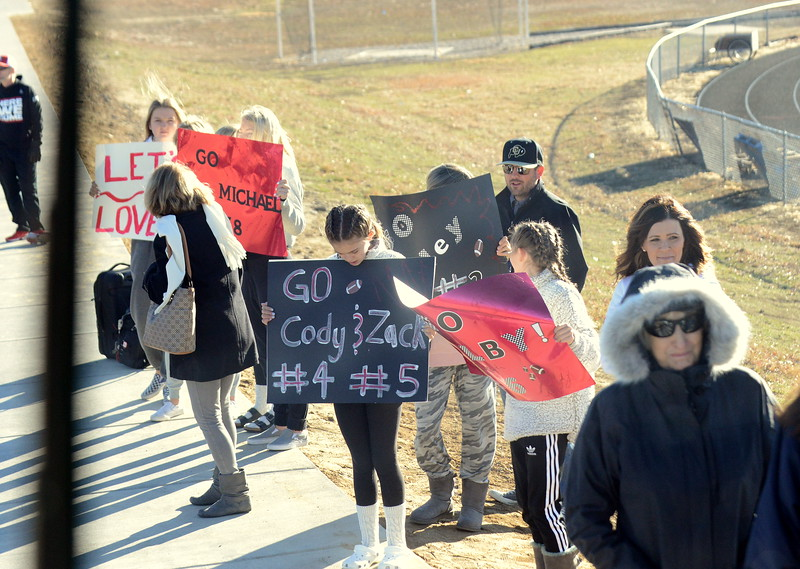 Friends and family of the Loveland football team gathered to see the group off as their bus departed for Montrose at 9 a.m. Friday morning. (Mike Brohard/Loveland Reporter-Herald)