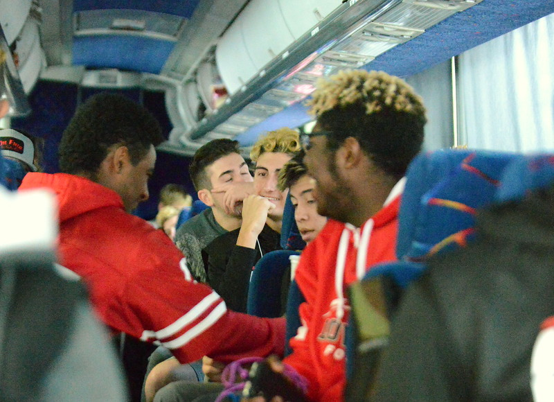 Loveland football players passed the time on Friday's bus ride to Montrose by telling stories, joking with each other. listening to music and watching game film on the bus. (Mike Brohard/Loveland Reporter-Herald)