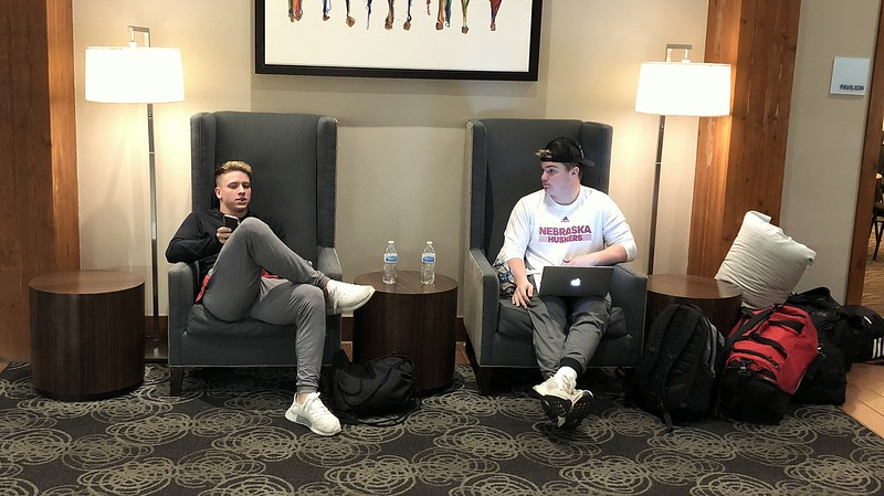 Loveland's Zach Weinmaster (left) and Michael Deschene sit in the hotel lobby, waiting to say hello to their parents when they arrive in Montrose. (Mike Brohard/Loveland Reporter-Herald)