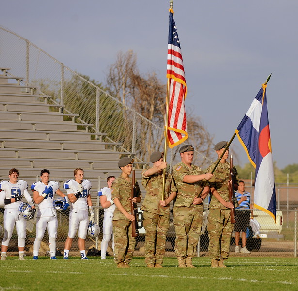 Loveland's Color Guard takes the field for the National Anthem prior to Thursday's game with Broomfield at Patterson Stadium. (Mike Brohard/Loveland Reporter-Herald)
