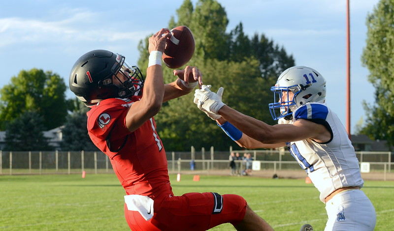 Loveland defensive back Isaiah Meyers breaks up a pass intended for Broomfield's Mitchell Morales in Thursday's game at Patterson Stadium. (Mike Brohard/Loveland Reporter-Herald)