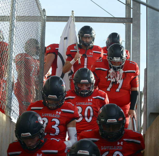 Loveland's football team exits the locker room and heads down the stairs at Patterson Stadium, ready to open the 2018 season Thursday night with Broomfield. (Mike Brohard/Loveland Reporter-Herald)