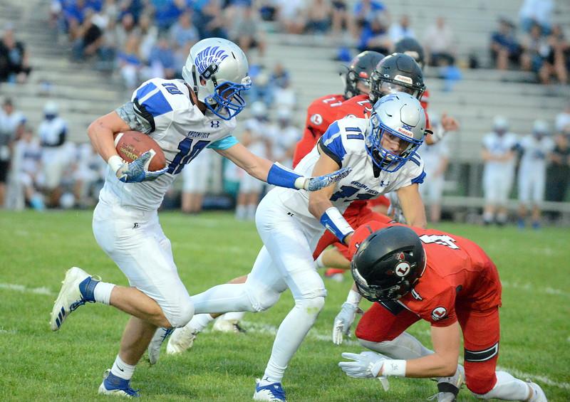 Loveland's Cody Rakowsky avoids the block of Broomfield's Mitchell Morales to make the stop on Samuel Godwin in Thursday's game at Patterson Stadium. (Mike Brohard/Loveland Reporter-Herald)